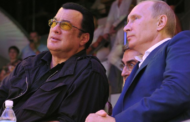 Putin presents actor Steven Seagal with Russian passport